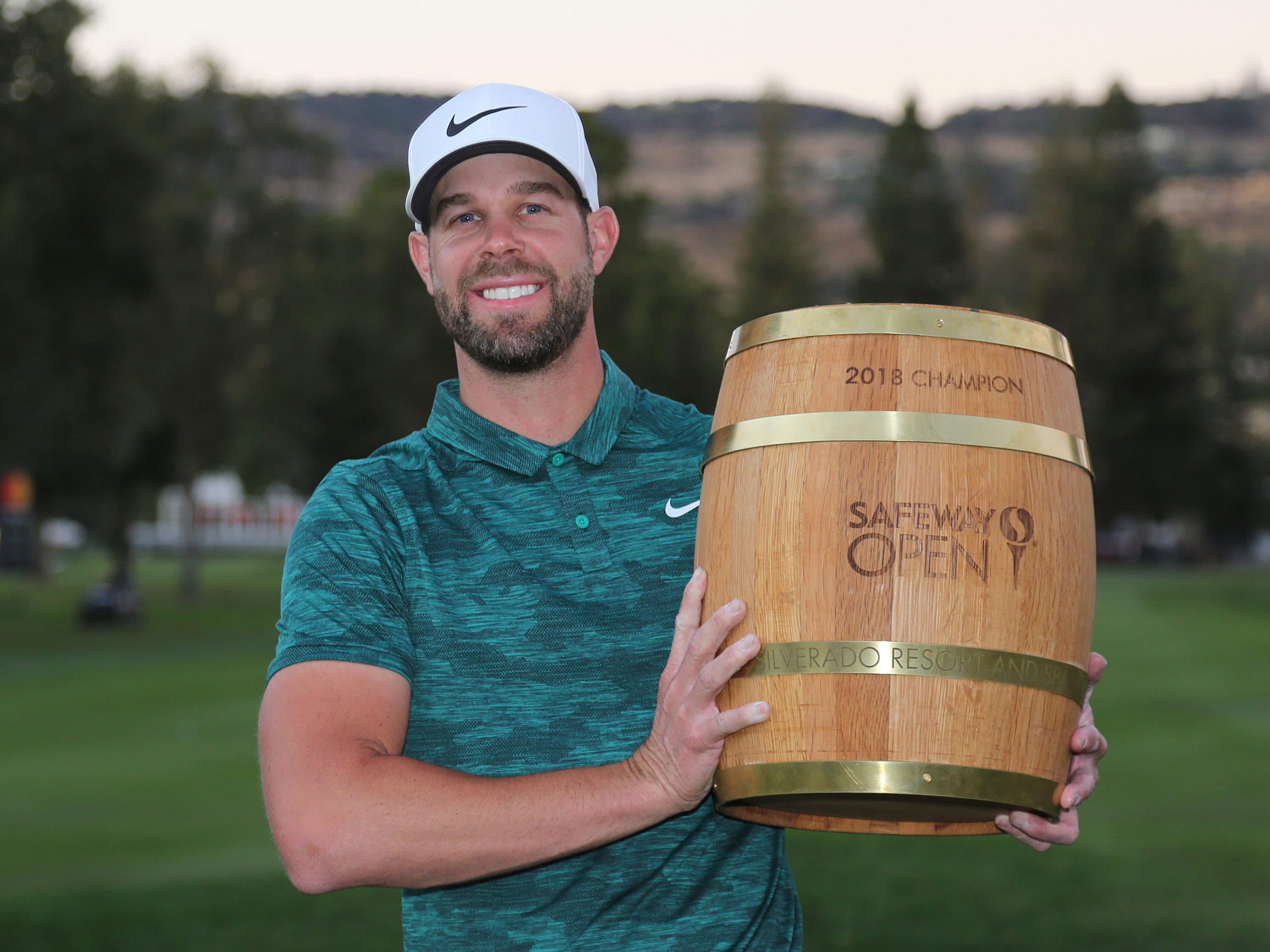 Oct. 7: Kevin Tway poses with his trophy on the 18th green of the Silverado Resort North Course after winning the Safeway Open.
