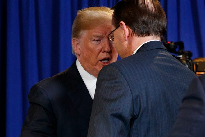 President Donald Trump shakes hands with Deputy Attorney General Rod Rosenstein after a White House meeting in May.
