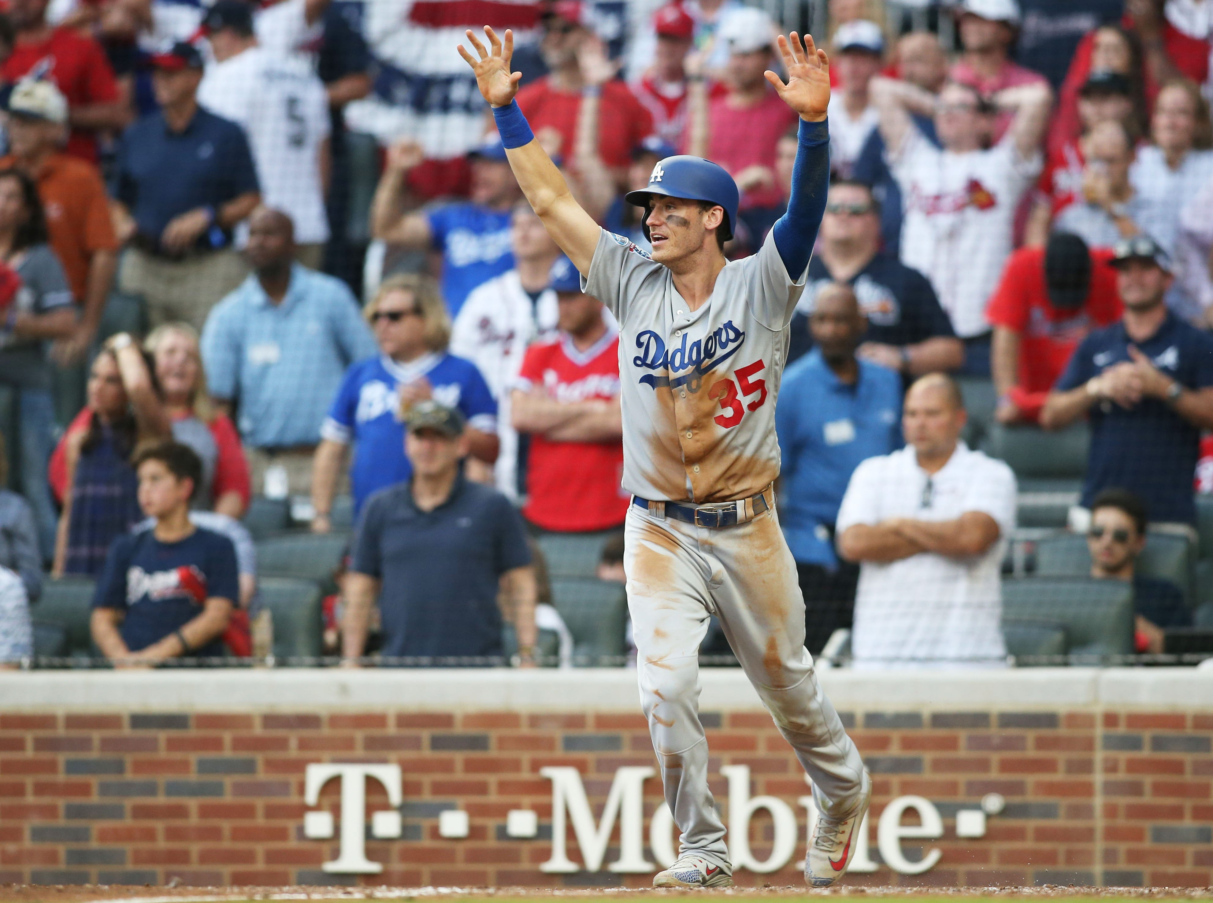 NLDS Game 4: Cody Bellinger reacts after scoring in the sixth inning.