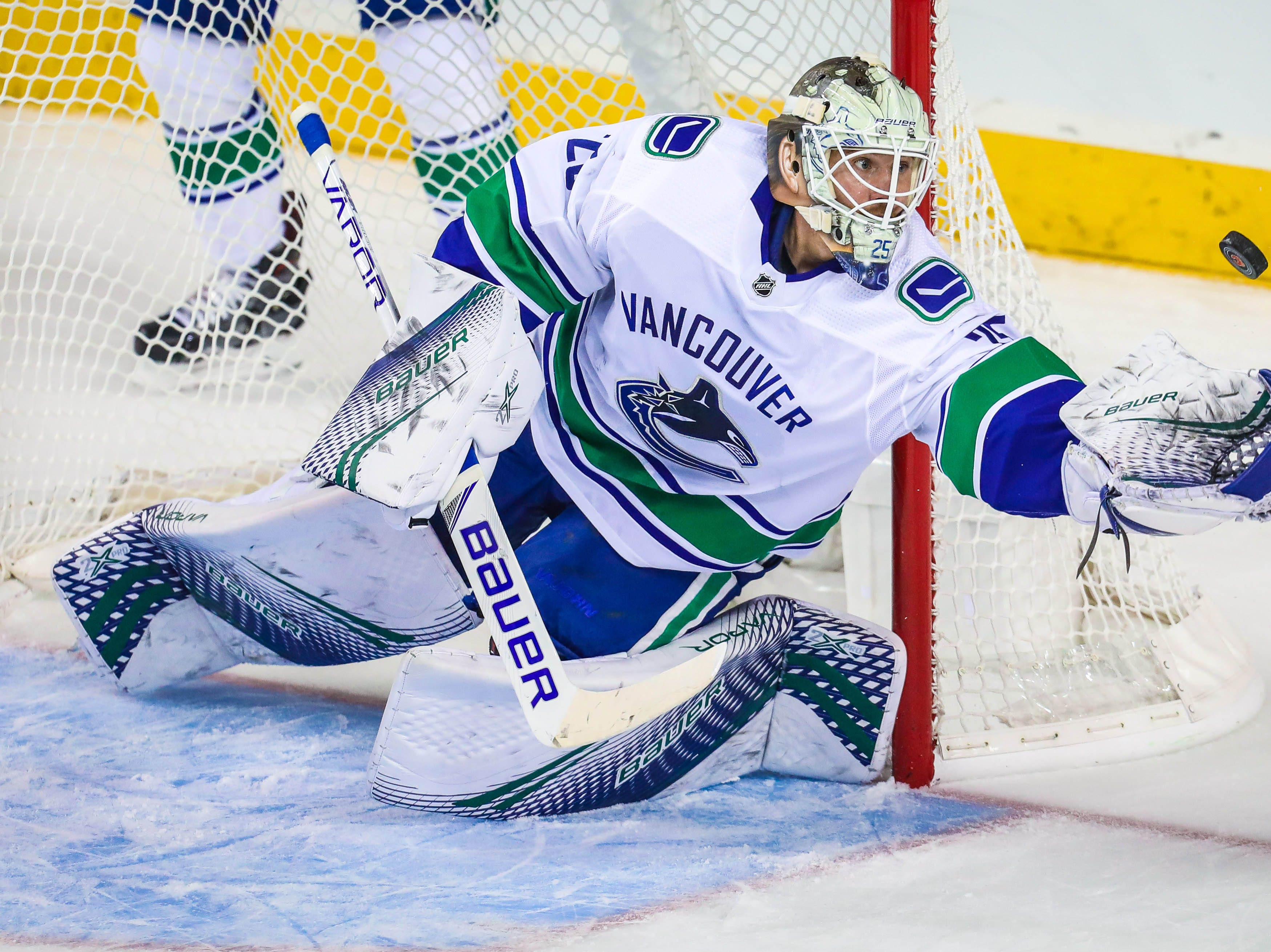 Oct. 6: Vancouver Canucks goaltender Jacob Markstrom makes a save against the Calgary Flames during the second period at Scotiabank Saddledome.