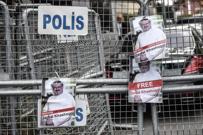 Pictures of missing journalist Jamal Khashoggi on a police fence at a protest in front of the Saudi Arabian Consulate in Istanbul on Oct. 8, 2018.