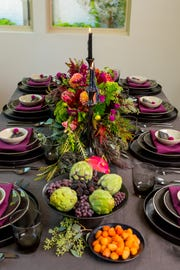 Colorful flowers can make your Halloween party table pop.