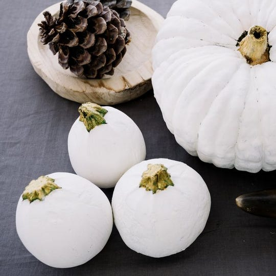 Paint your pumpkins black, gold or white to match your sophisticated theme.