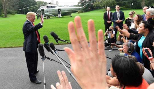 President Donald Trump speaks to reporters on the South Lawn of the White House on Monday.