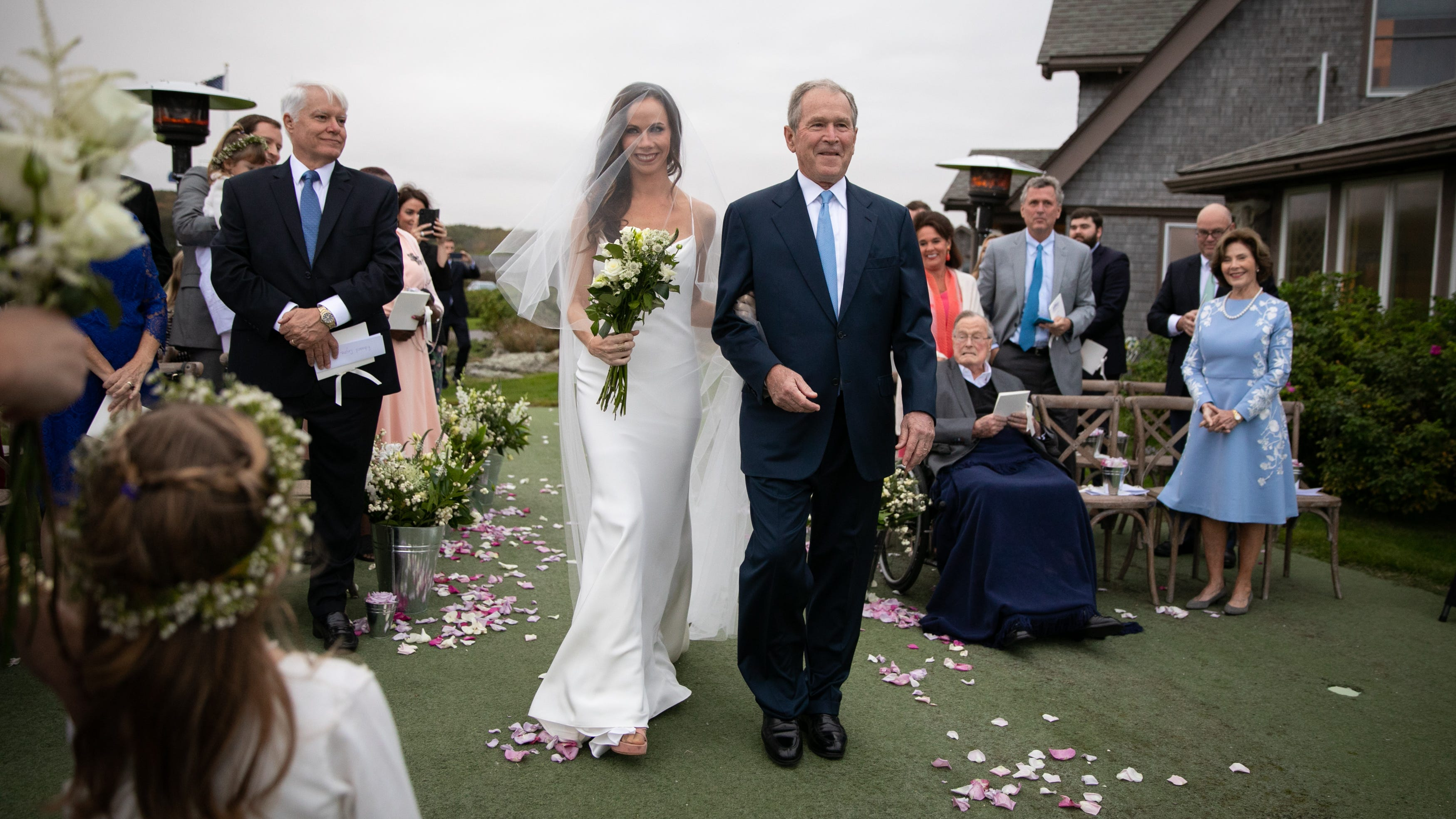 Barbara Pierce Bush walks down the aisle with her father George W. Bush on the occasion of her wedding to Craig Coyne in Kennebunkport, Maine, on Oct. 7, 2018.
