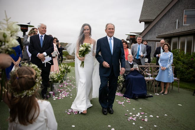 Barbara Pierce Bush walks down the aisle with her father George W. Bush at her wedding to Craig Coyne in Kennebunkport, Maine on October 7, 2018.