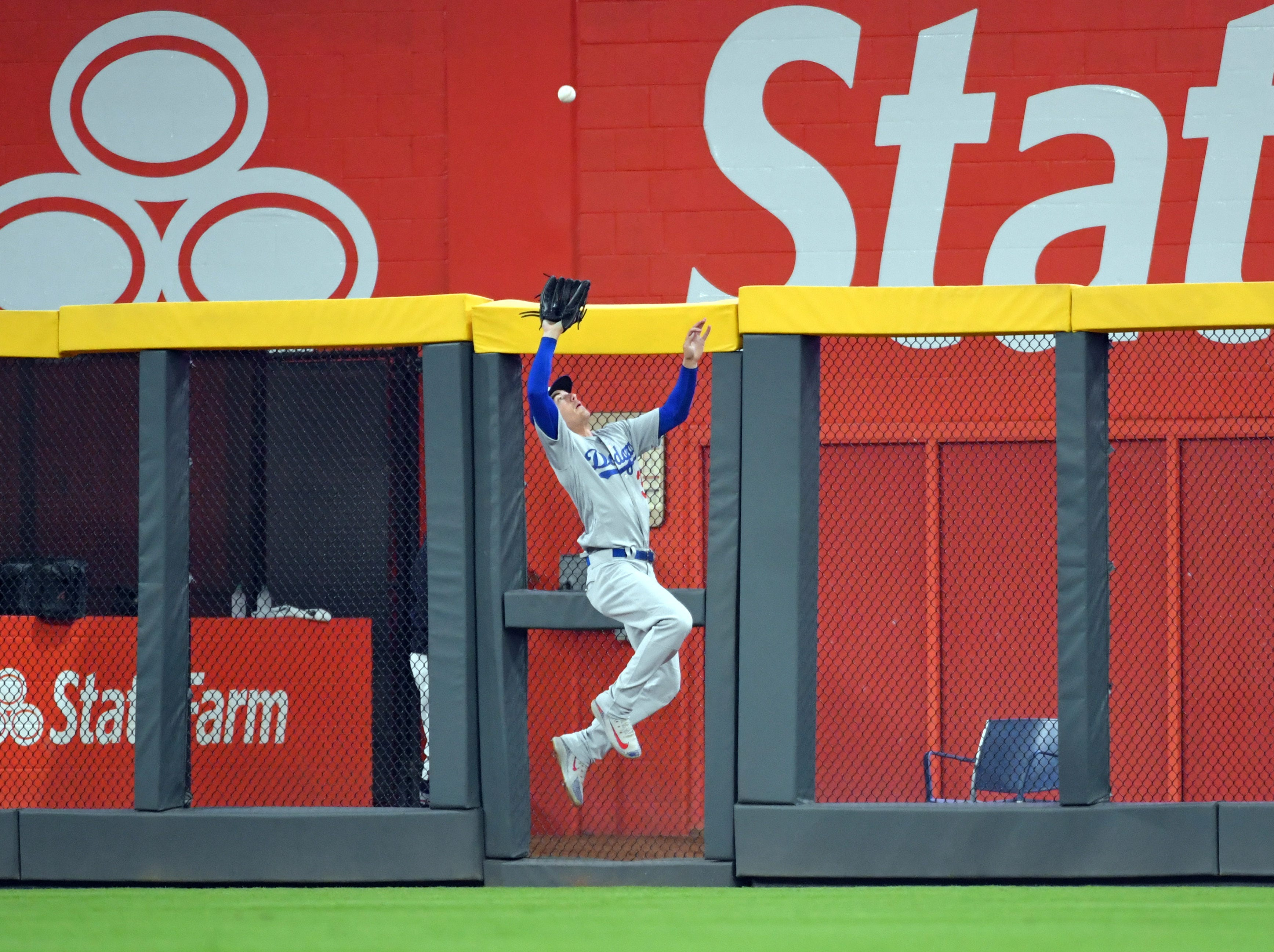 NLDS Game 3: Dodgers center fielder Cody Bellinger makes a leaping catch at the wall.