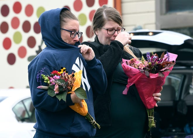 People place flowers at the scene of the limousine crash on Oct. 7, 2018, in Schoharie, N.Y.