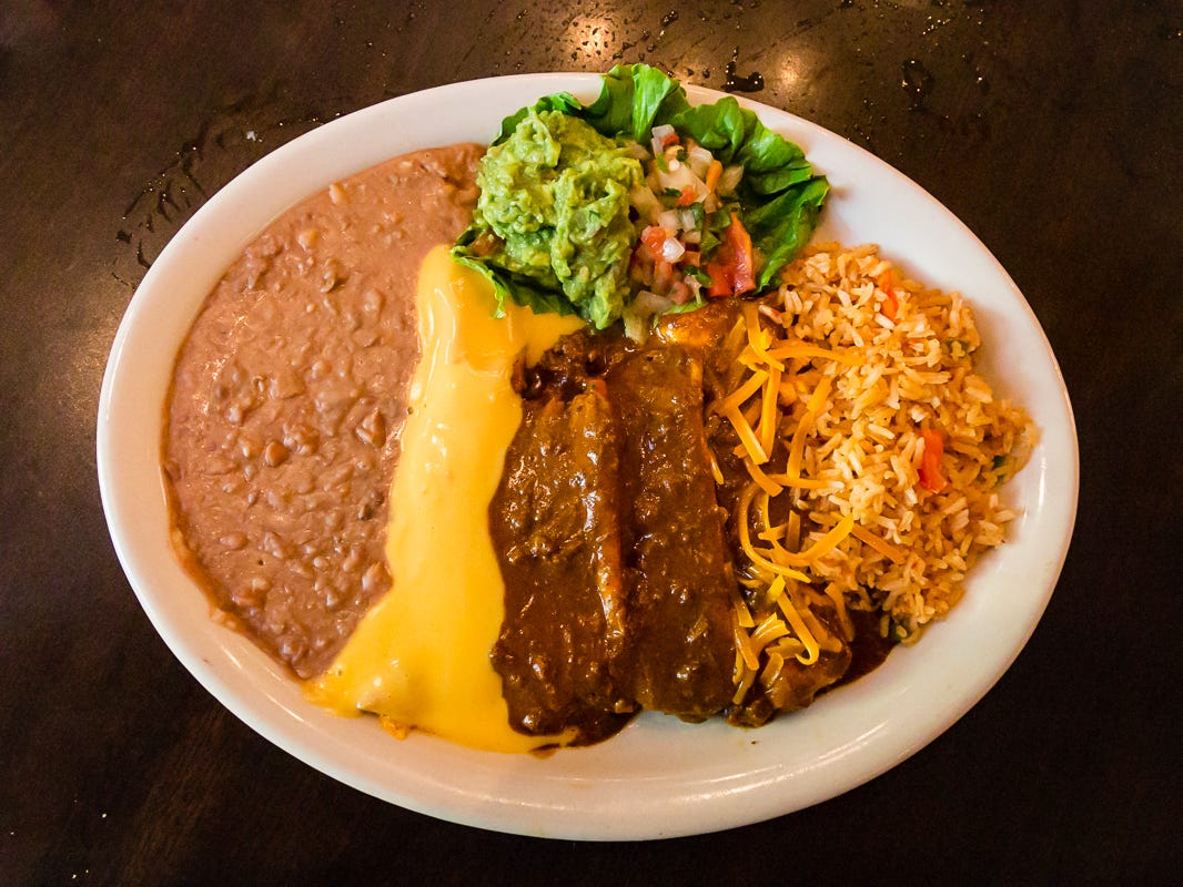 "An enchilada combo plate typifies classic Tex-Mex, and the ones you'll find at El Fenix are as good as you'll find in Texas. Among the best choices is their top-seller, the $13.99 ""El Fenix Dinner,"" comprised of one cheese enchilada with chili con carne, one picadillo beef taco, two tamales with chili con carne and guacamole."
