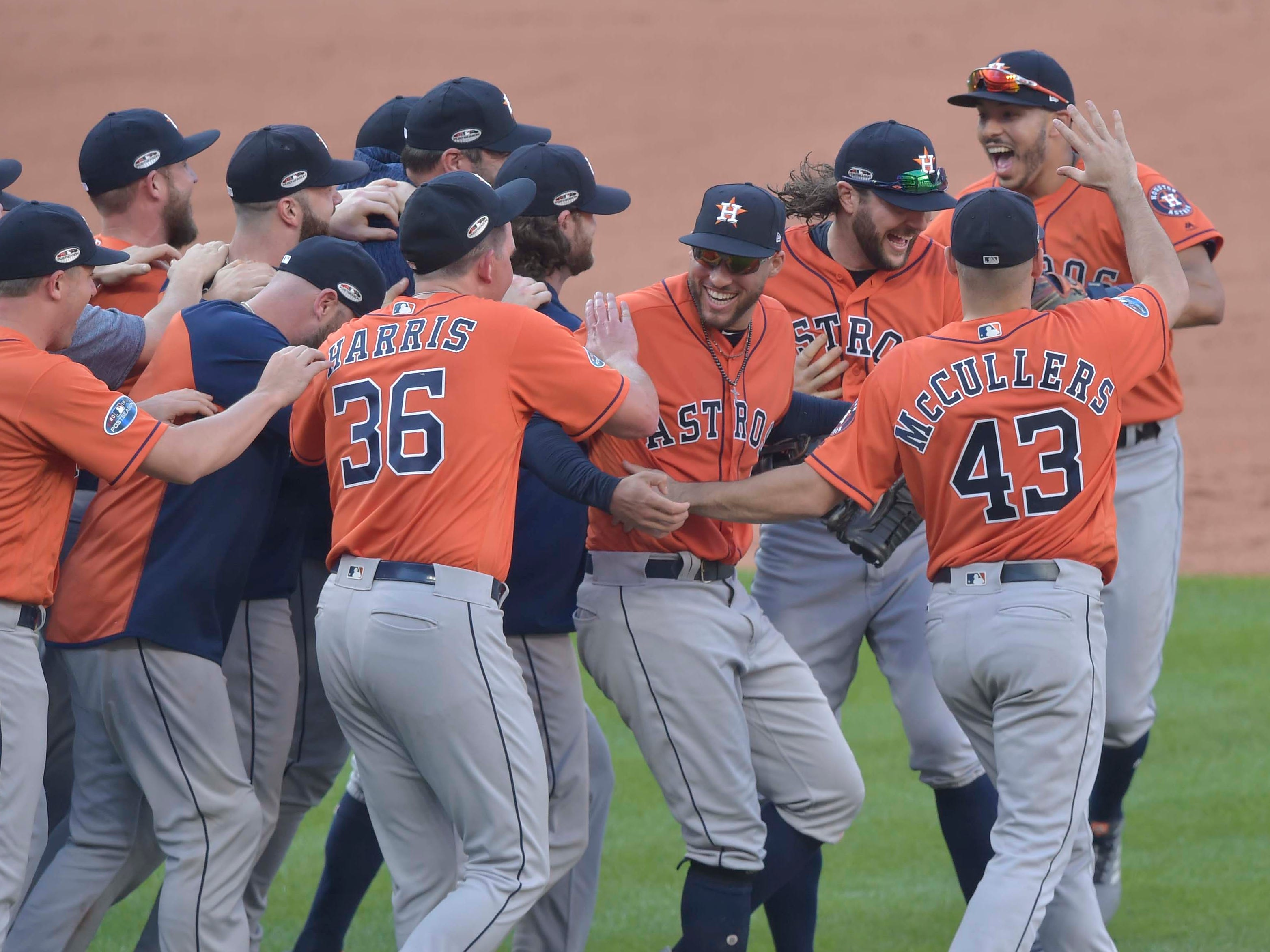 ALDS Game 3: Astros players celebrate after the series-clinching win.