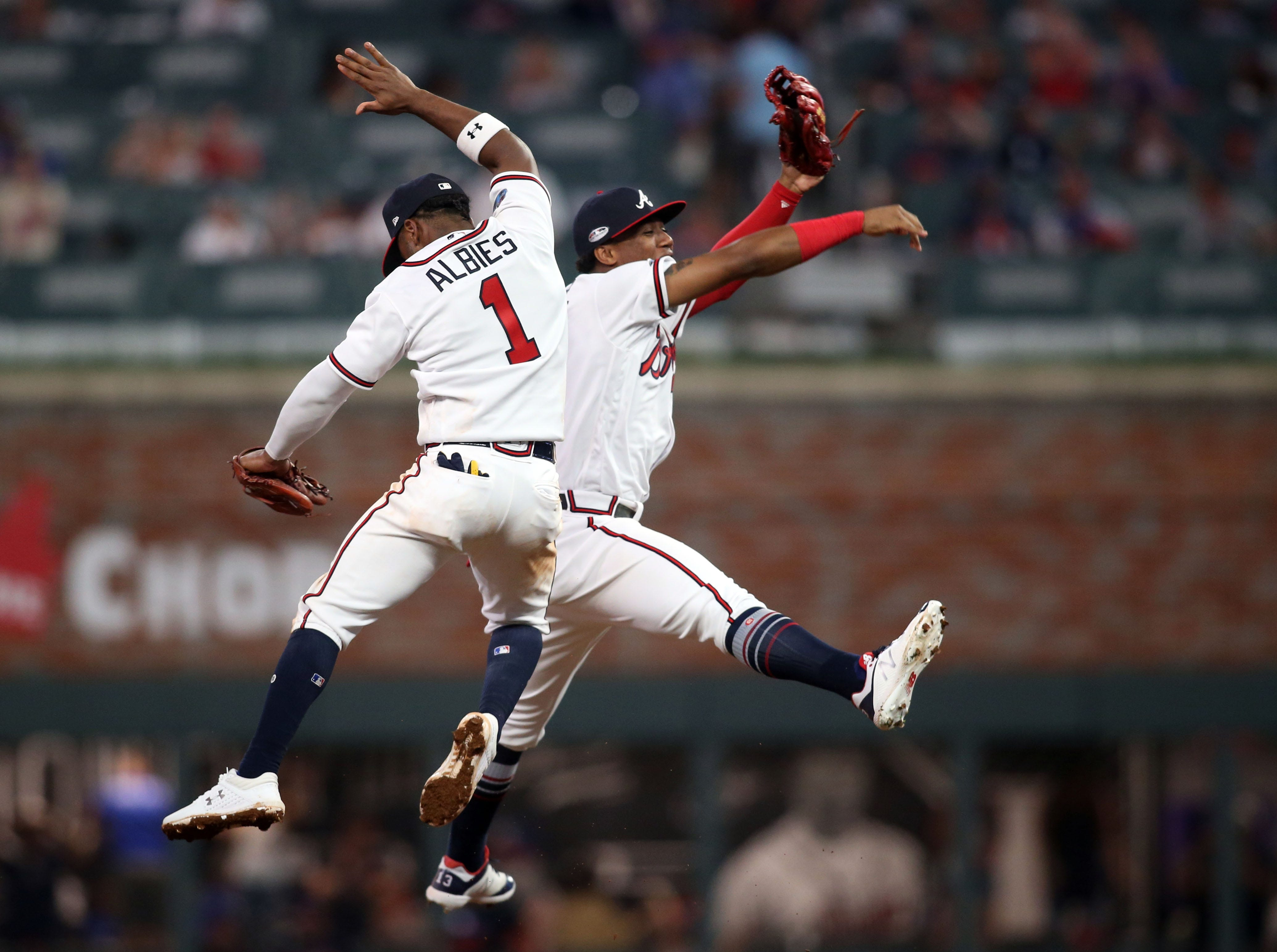NLDS Game 3: Ozzie Albies and Ronald Acuna celebrate the Braves' win.