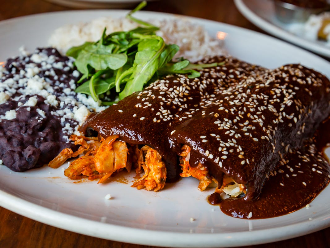 Newcomers to Dallas often think of Mesa Mayo's food as a refined version of Tex-Mex. These roasted chicken enchiladas sauced with from-scratch mole and sided with black beans and rice explain why.