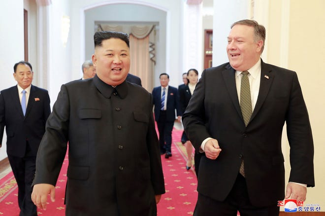 """This picture taken on October 7, 2018 and released by North Korea's official Korean Central News Agency (KCNA) on October 8, 2018 via KNS shows North Korea's leader Kim Jong Un (L) greeting US Secretary of State Mike Pompeo (R) at the Paekhwawon State Guesthouse in Pyongyang. - Kim Jong Un has agreed to hold a second summit with US President Donald Trump as soon as possible, Seoul said on October 7, after Washington's top diplomat held """"productive"""" talks on denuclearisation with the North Korean leader in Pyongyang. (Photo by KCNA VIA KNS / KCNA VIA KNS / AFP) /"""
