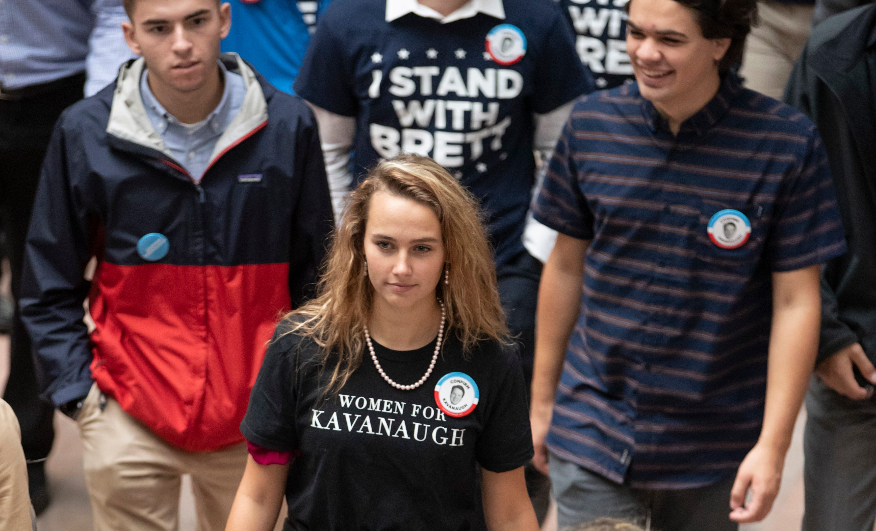 Supporters of Supreme Court nominee Brett Kavanaugh walk through the Hart Senate Office Building as the Senate Judiciary Committee hears from Kavanaugh and Christine Blasey Ford on Capitol Hill in Washington, Sept. 27, 2018.