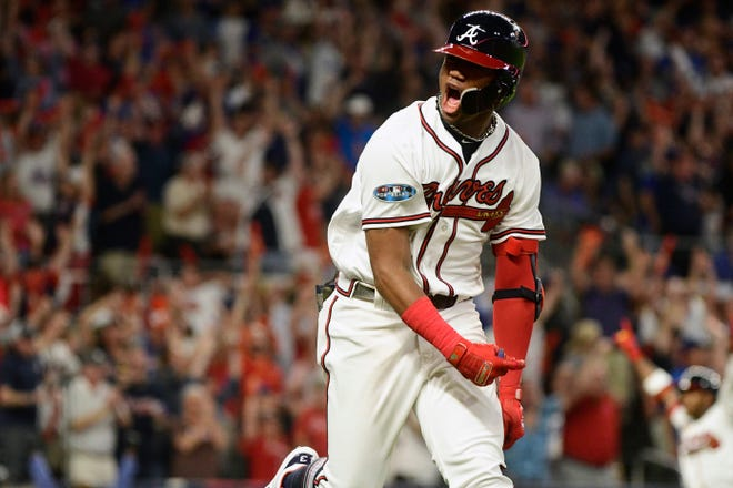 Ronald Acuna Jr. celebrates his grand slam in the second inning.