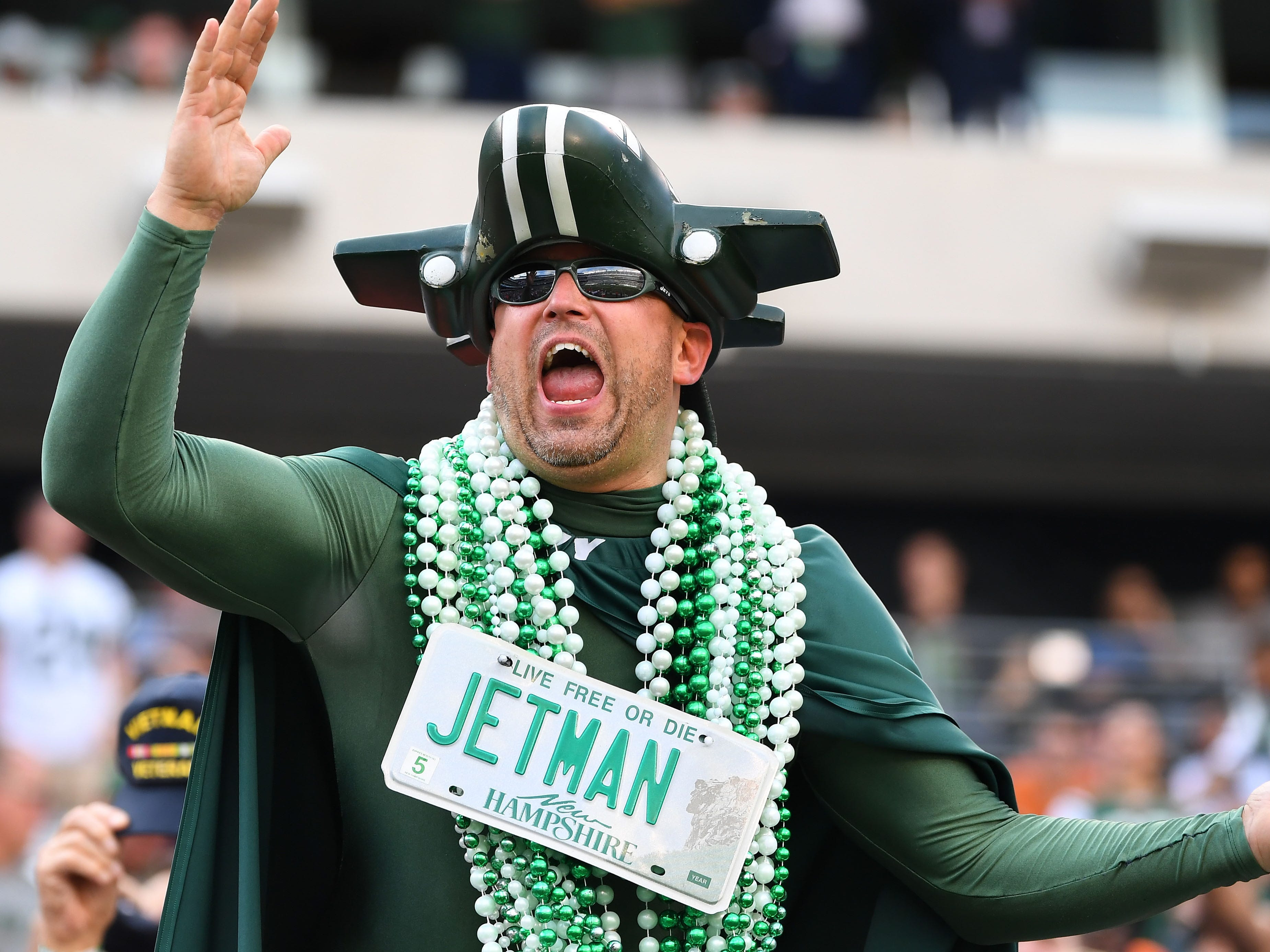 A New York Jets fan cheers from the stand during the game against the Denver Broncos at MetLife Stadium.