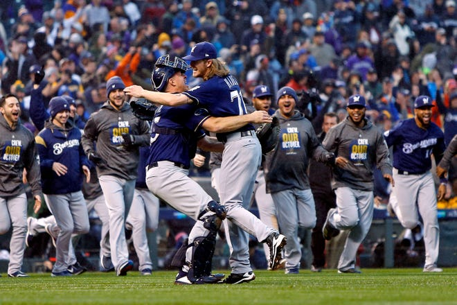 Oct 7, 2018; Denver, CO, USA; Milwaukee Brewers relief pitcher Josh Hader (71) celebrates with catcher Erik Kratz (15) after beating the Colorado Rockies in game three of the 2018 NLDS playoff baseball series at Coors Field. Mandatory Credit: Russell Lansford-USA TODAY Sports