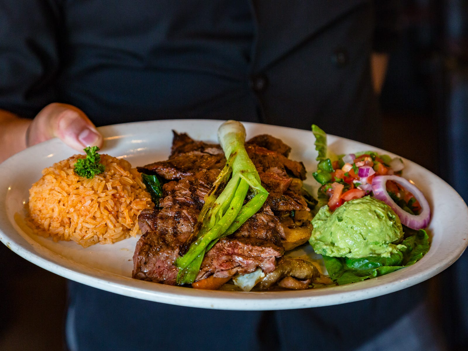 Grilled skirt steak, Mexican rice, guacamole and pico de gallo make this carne asada at La Comida a fajita plate with few equals in town.