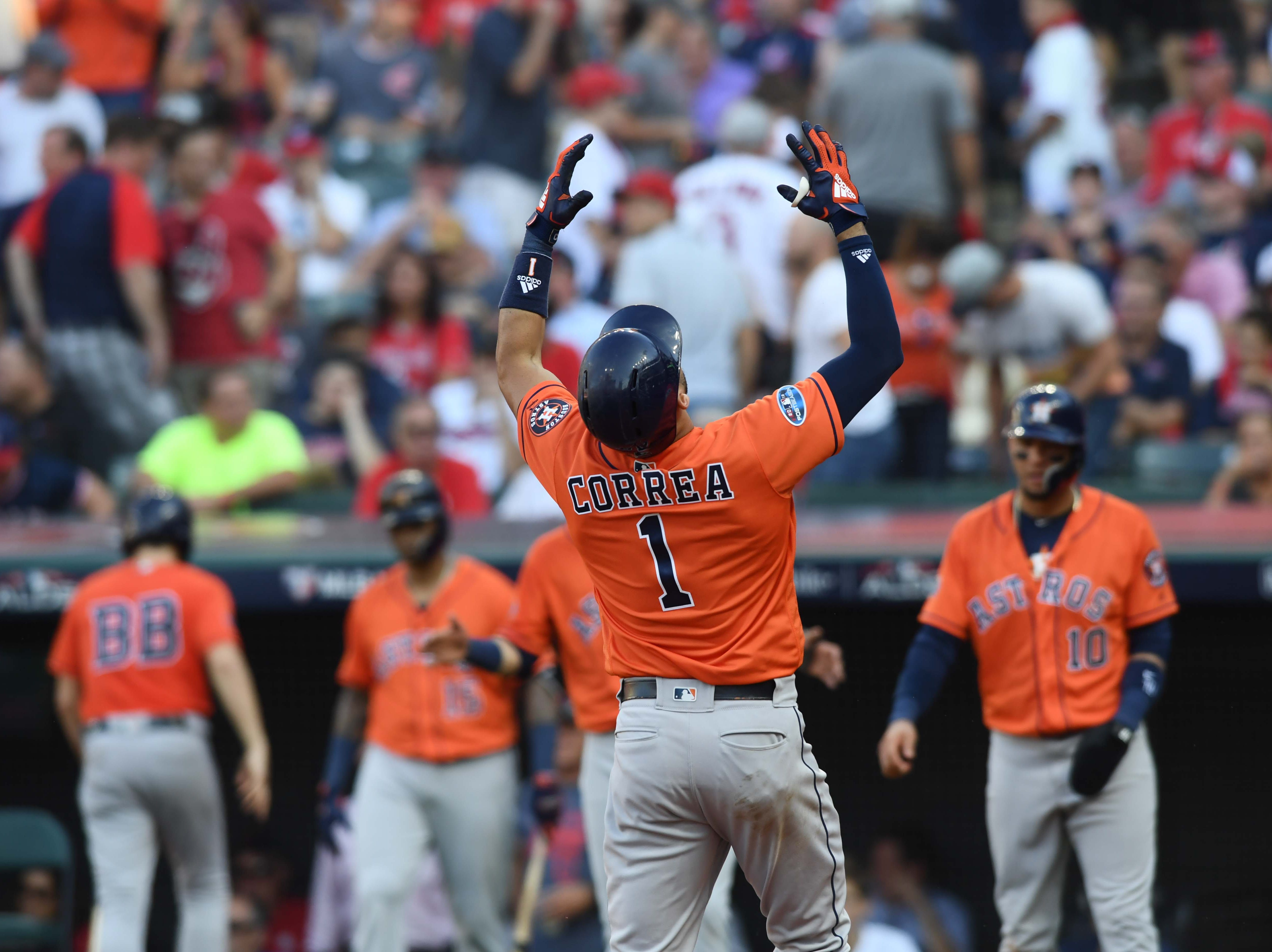 ALDS Game 3: Carlos Correa reacts after his three-run homer in the eighth.
