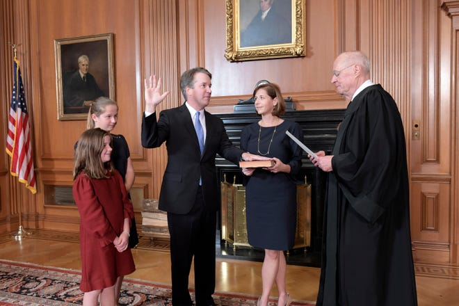 Retired Supreme Court Justice Anthony Kennedy swears in his replacement, Brett Kavanaugh, following a blistering confirmation battle.
