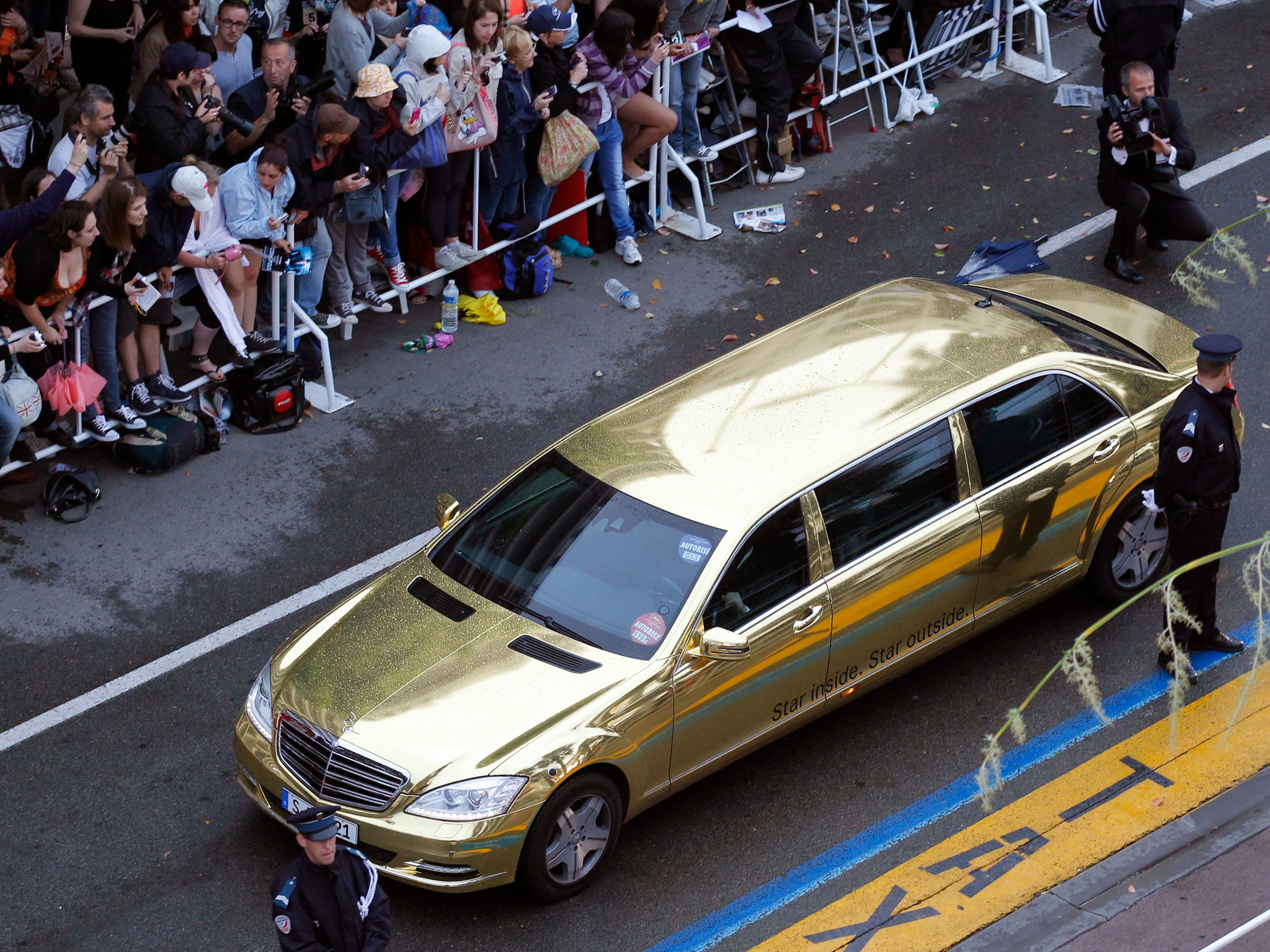 This is a gold colored limo in Cannes, France May, 35, 2012.