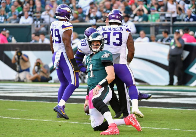 Philadelphia Eagles quarterback Carson Wentz (11) reacts after being sacked by Minnesota Vikings defensive tackle Linval Joseph (98) during the first quarter at Lincoln Financial Field.