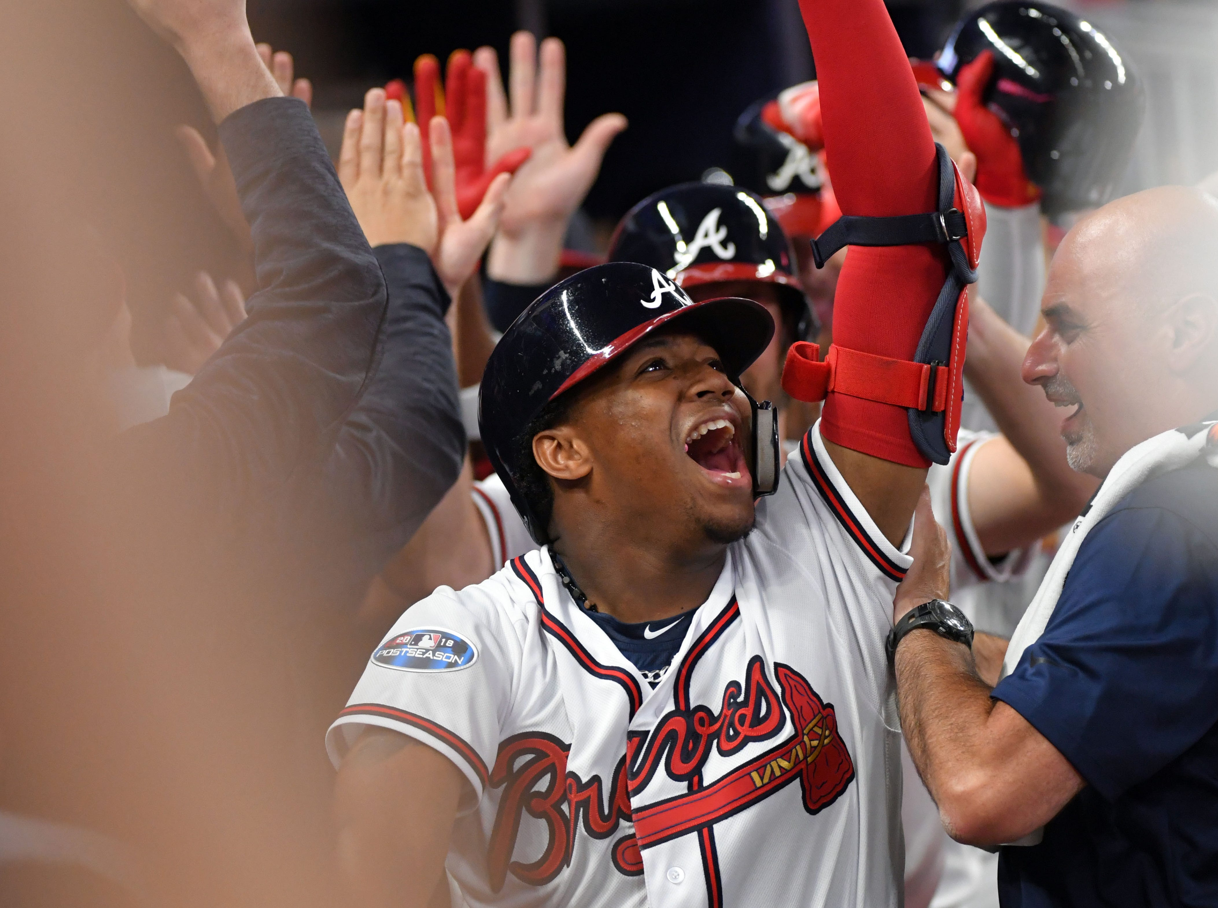 NLDS Game 3: Braves outfielder Ronald Acuna celebrates his grand slam in the second inning.