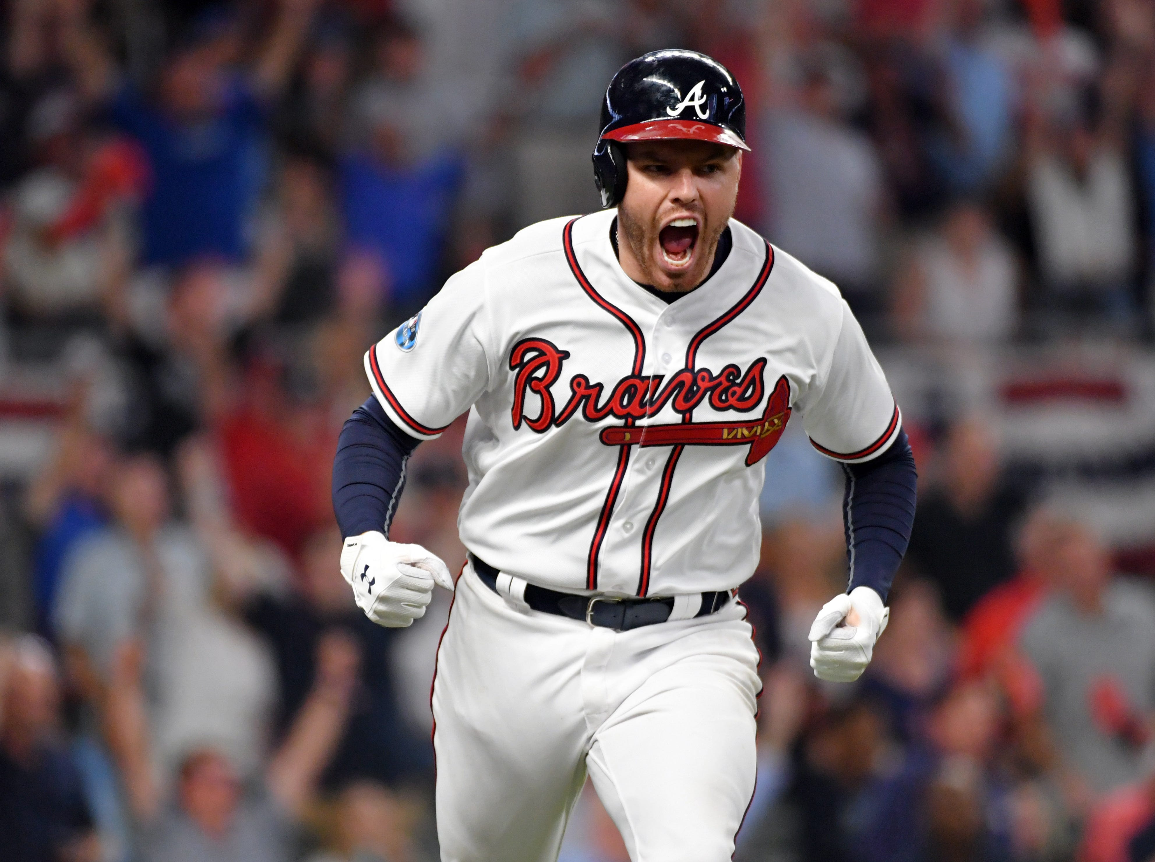 NLDS Game 3: Braves first baseman Freddie Freeman celebrates his solo homer in the sixth inning.