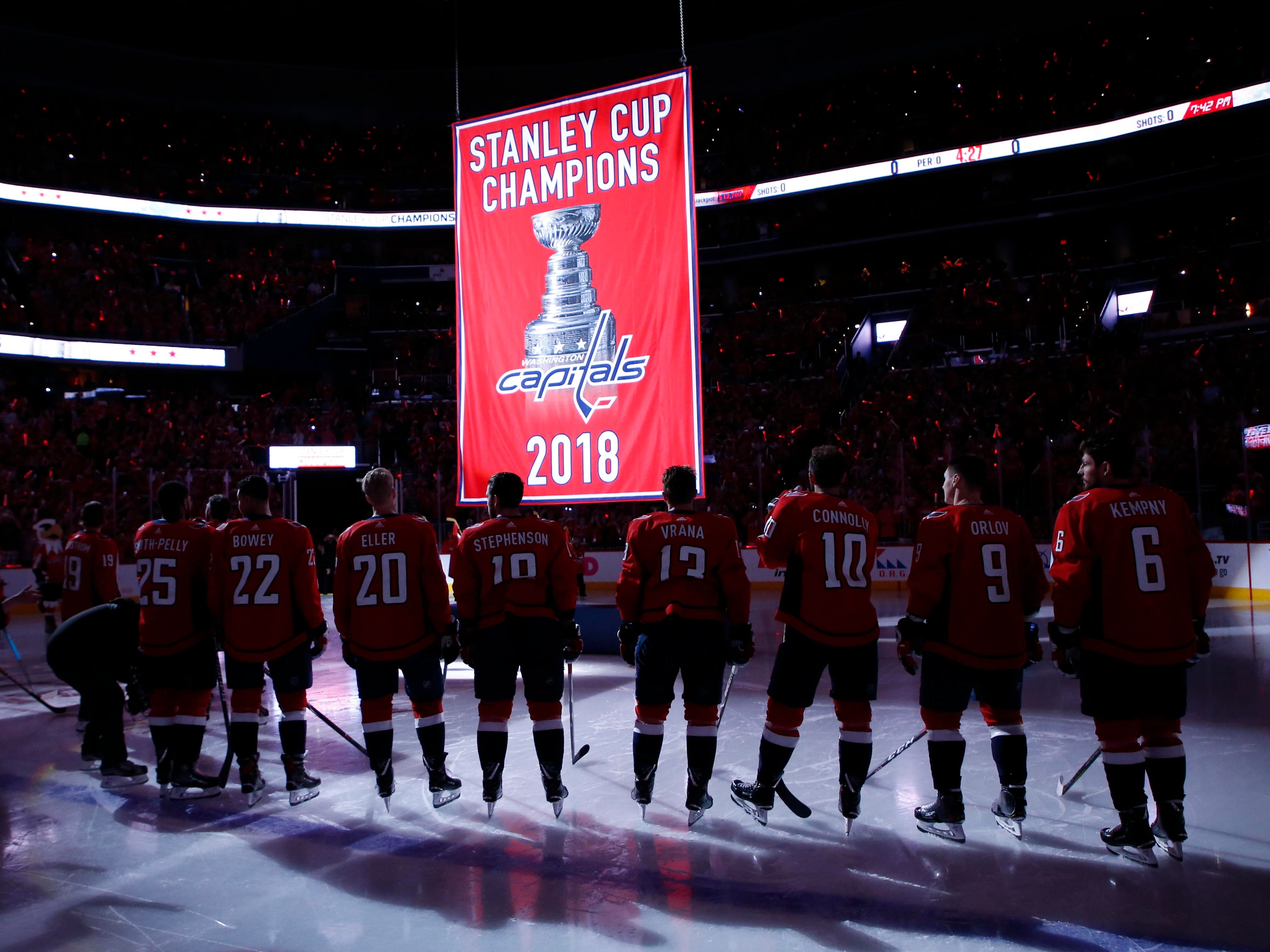 Oct. 3: Washington Capitals players watch as the 2018 Stanley Cup championship banner is raised to the rafters before the game against the Boston Bruins.