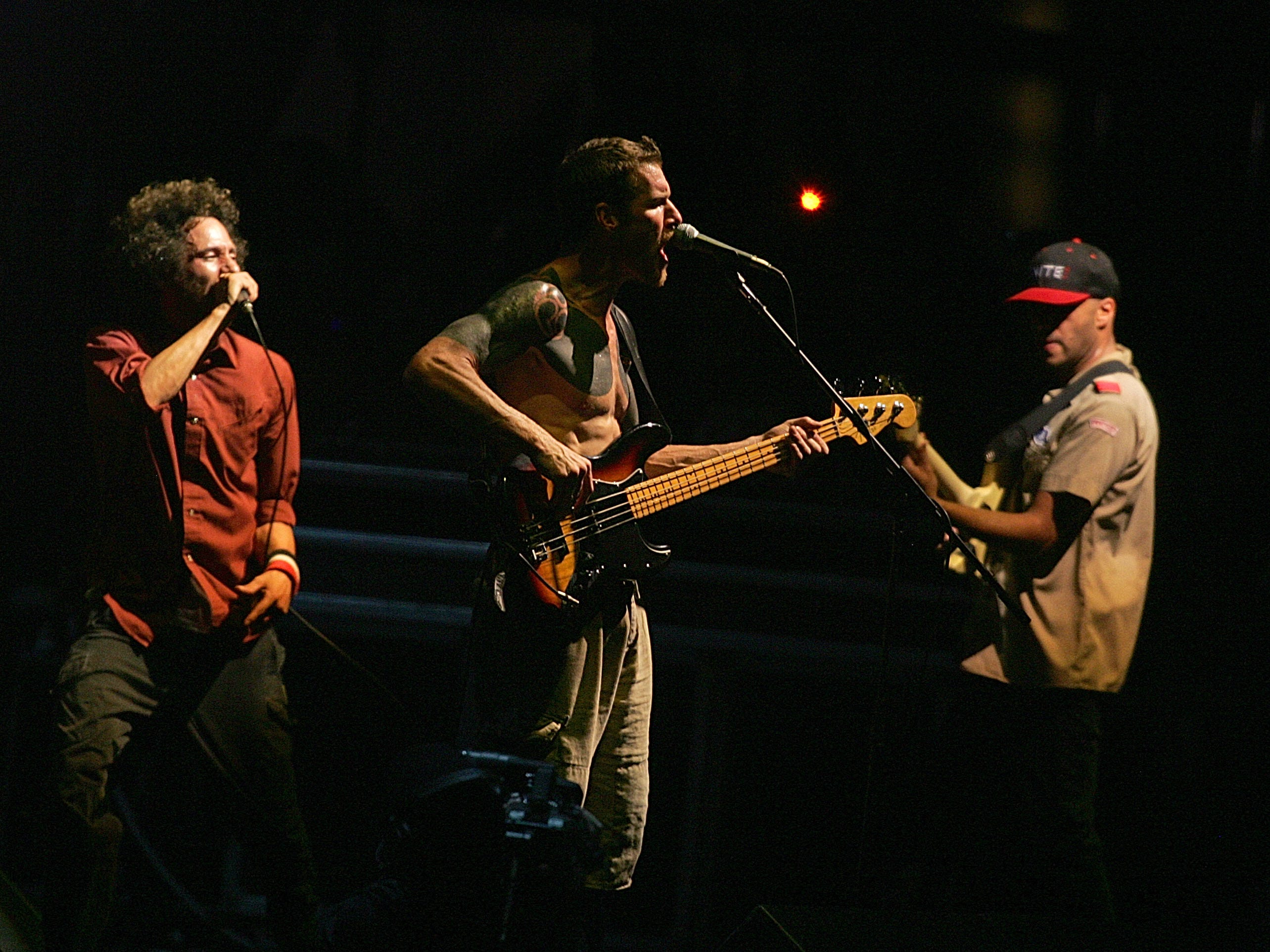 Rage Against the Machine. From left, Zack de la Rocha, Tim Commerford, center and Tom Morello of the musical group perform at the Coachella Valley Music and Arts Festival in Indio, California, April 29, 2007.