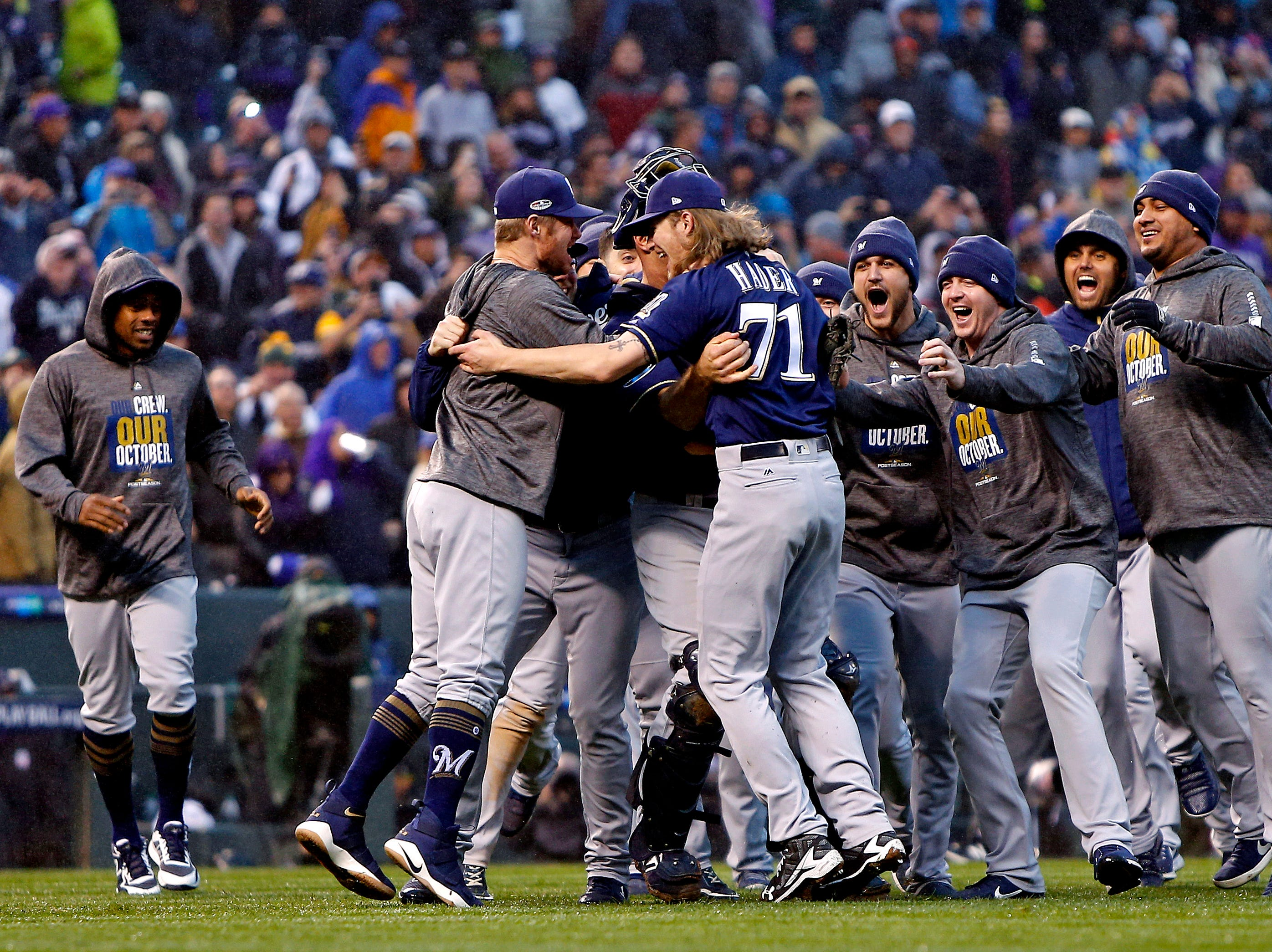 NLDS Game 3: Brewers players celebrate after the 6-0 win to sweep the series.