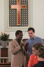 "Quarante ""Naledge"" Powell, left, shows some of his Christian hip hop music  at Christ the Redeemer - Greenville."