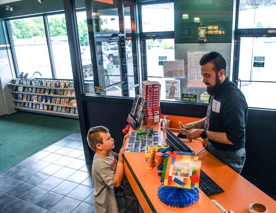 Oliver Todd of Starr buys some candy from manager James Werner with money his father Zenas Todd gave him. Werner said nostalgia is a big factor in why people still come to the store to rent movies.