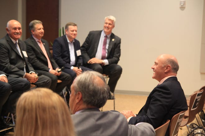 Clemson University's president Jim Clements listens as advanced manufacturing panelists discuss the industry.