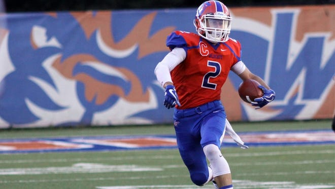 Louisiana College receiver Drake Battaglia looks to pick up yards during Saturday's game against Texas Lutheran.