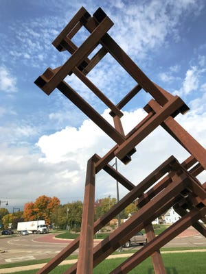 """The metal sculpture """"THEB: Stacked"""" is mounted near the East College Avenue roundabout. It will be in place for two years."""