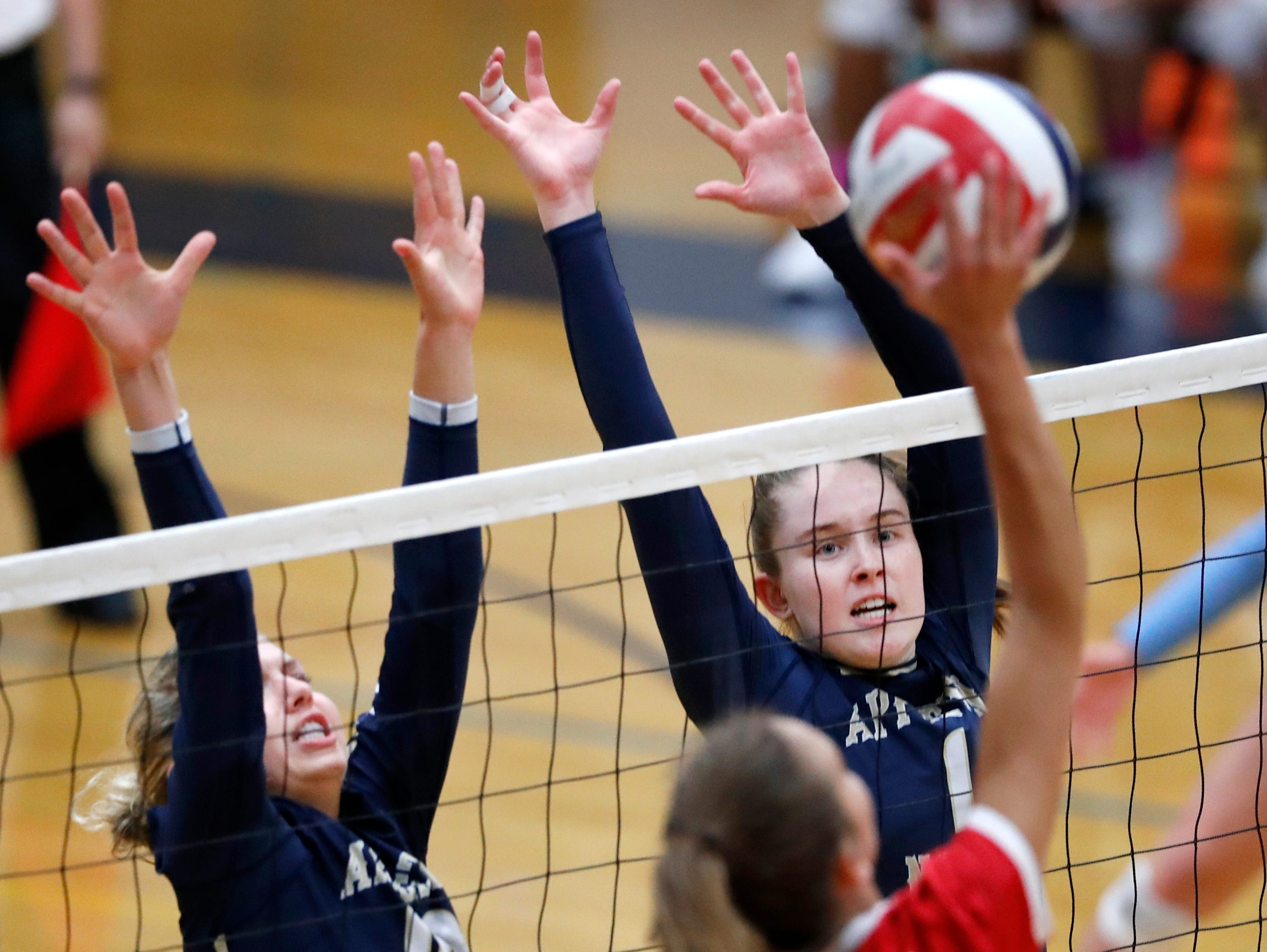 Neenah High School's Addison Barnes sends the ball toward Appleton North High School blockers 