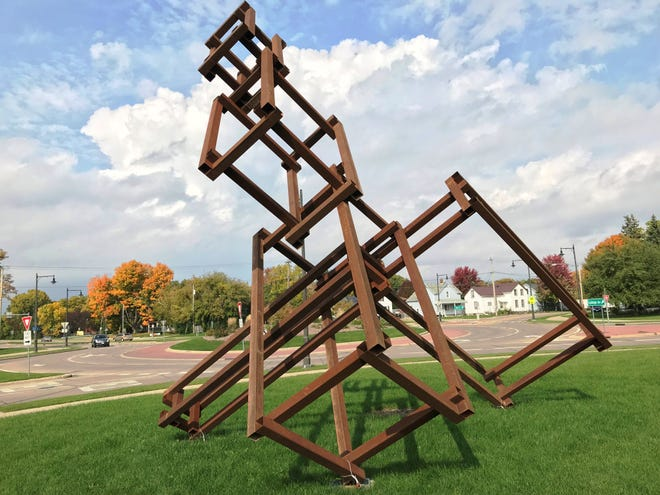 "Appleton's latest public artwork, titled ""THEB: Stacked,"" didn't cost any tax money. It is located at the east end of the College Avenue bridge."