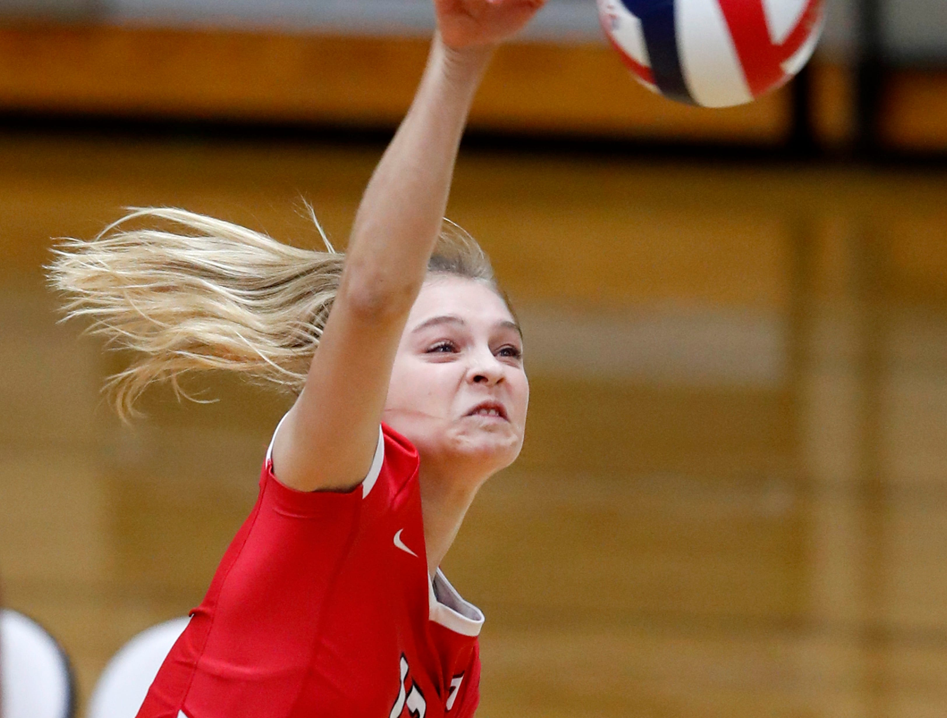 Neenah High School's Ava Aldag spikes the ball toward Appleton North High School Thursday, Oct. 4, 2018, in Appleton, Wis.