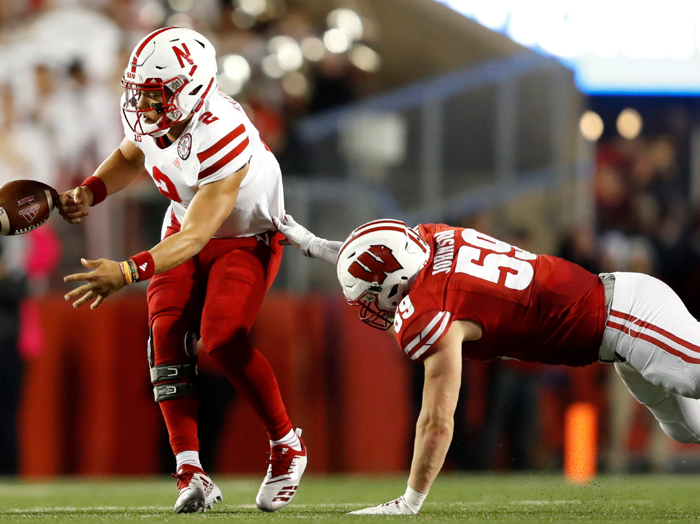 Nebraska quarterback Adrian Martinez fumbles the ball as Wisconsin linebacker Tyler Johnson puts pressure on him Saturday, Oct. 6, 2018, at Camp Randall Stadium in Madison, Wis.