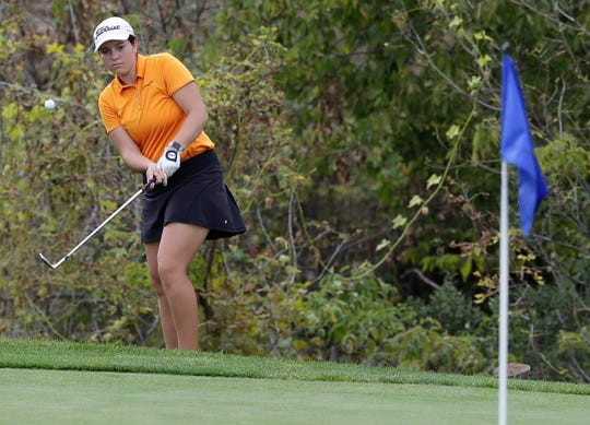 Lily Sheppard of Kaukauna chips onto the green during Friday's first round of the state tournament at University Ridge.