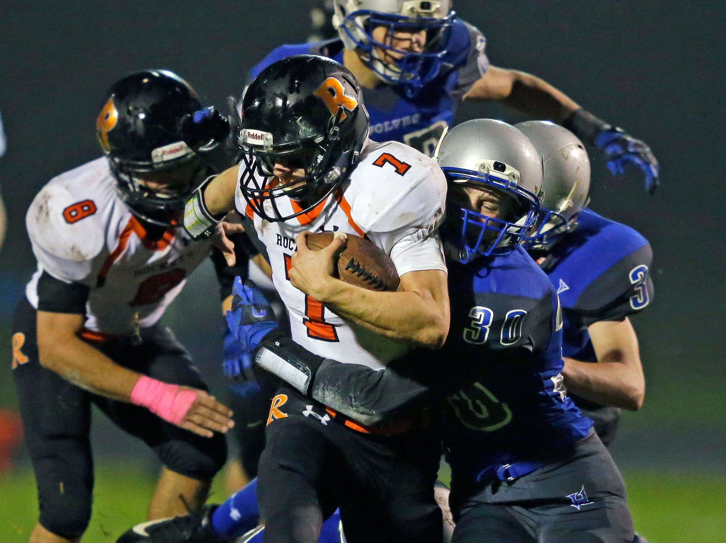 Michael Navis of Cedar Grove-Belgium carries the ball against Hilbert in a game for the Big East Conference title Friday, October 5, 2018, at Hilbert High School in Hilbert, Wis.