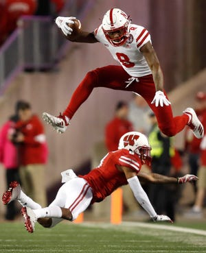 Nebraska wide receiver Stanley Morgan Jr. leaps over Wisconsin cornerback Deron Harrell Saturday, Oct. 6, 2018, at Camp Randall Stadium in Madison, Wis.