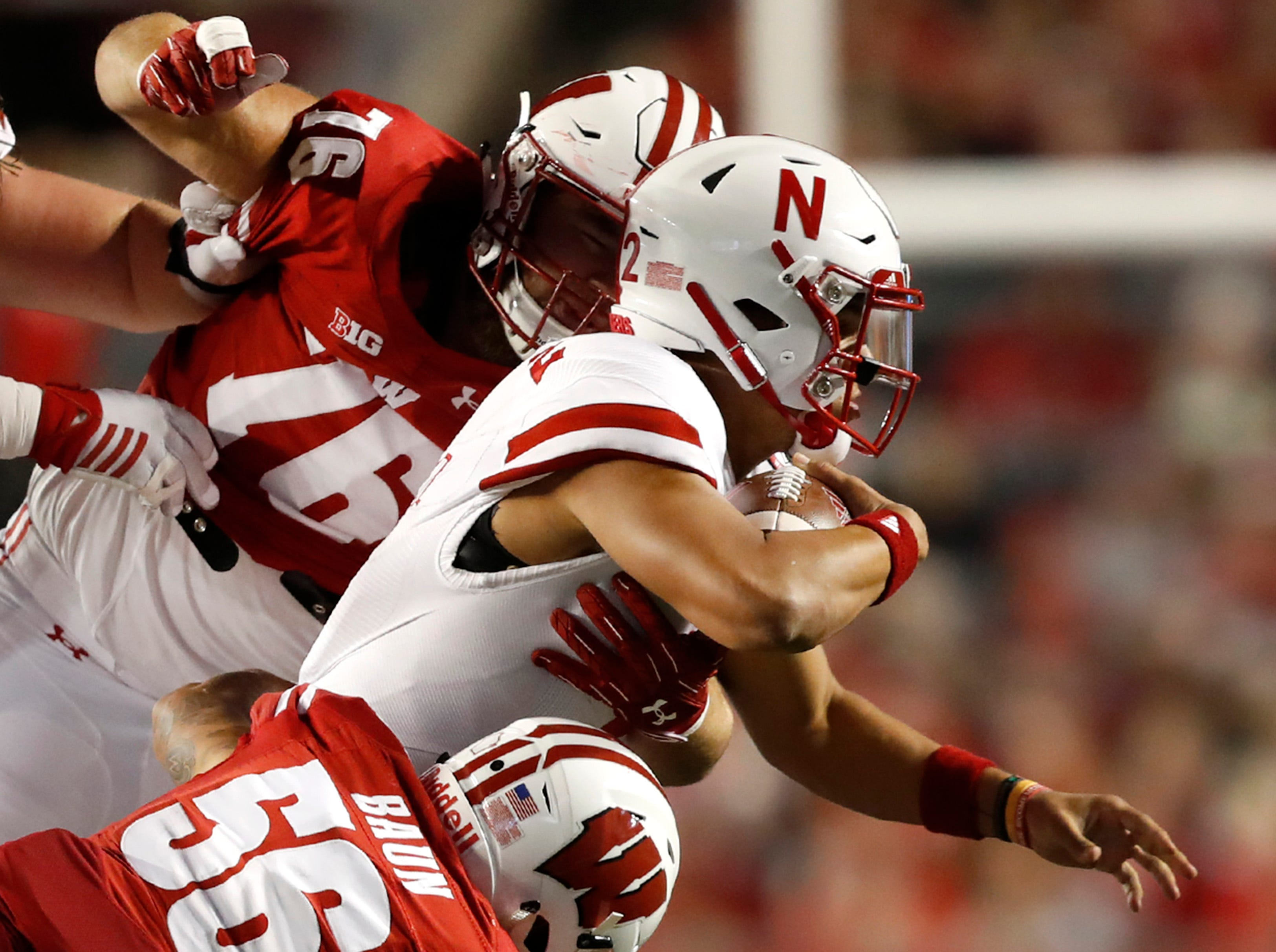 Nebraska quarterback Adrian Martinez is brought down by the Wisconsin defense Saturday, Oct. 6, 2018, at Camp Randall Stadium in Madison, Wis.