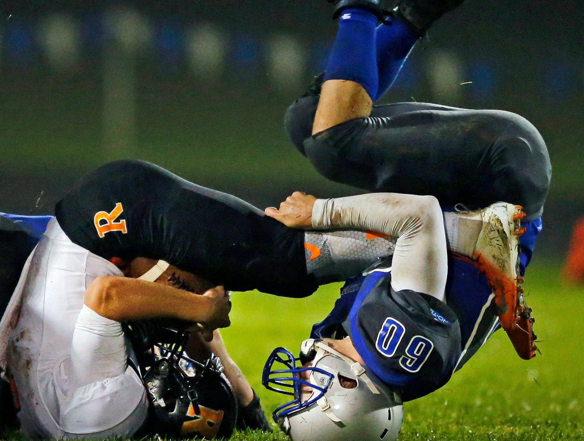 Rece Sweere, right, of Hilbert tackles Chris Jentges of Cedar Grove-Belgium in a game for the Big East Conference title Friday, October 5, 2018, at Hilbert High School in Hilbert, Wis.