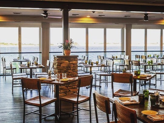 The dining room at Proving Ground Waterfront Restaurant in Highlands overlooks Sandy Hook Bay.