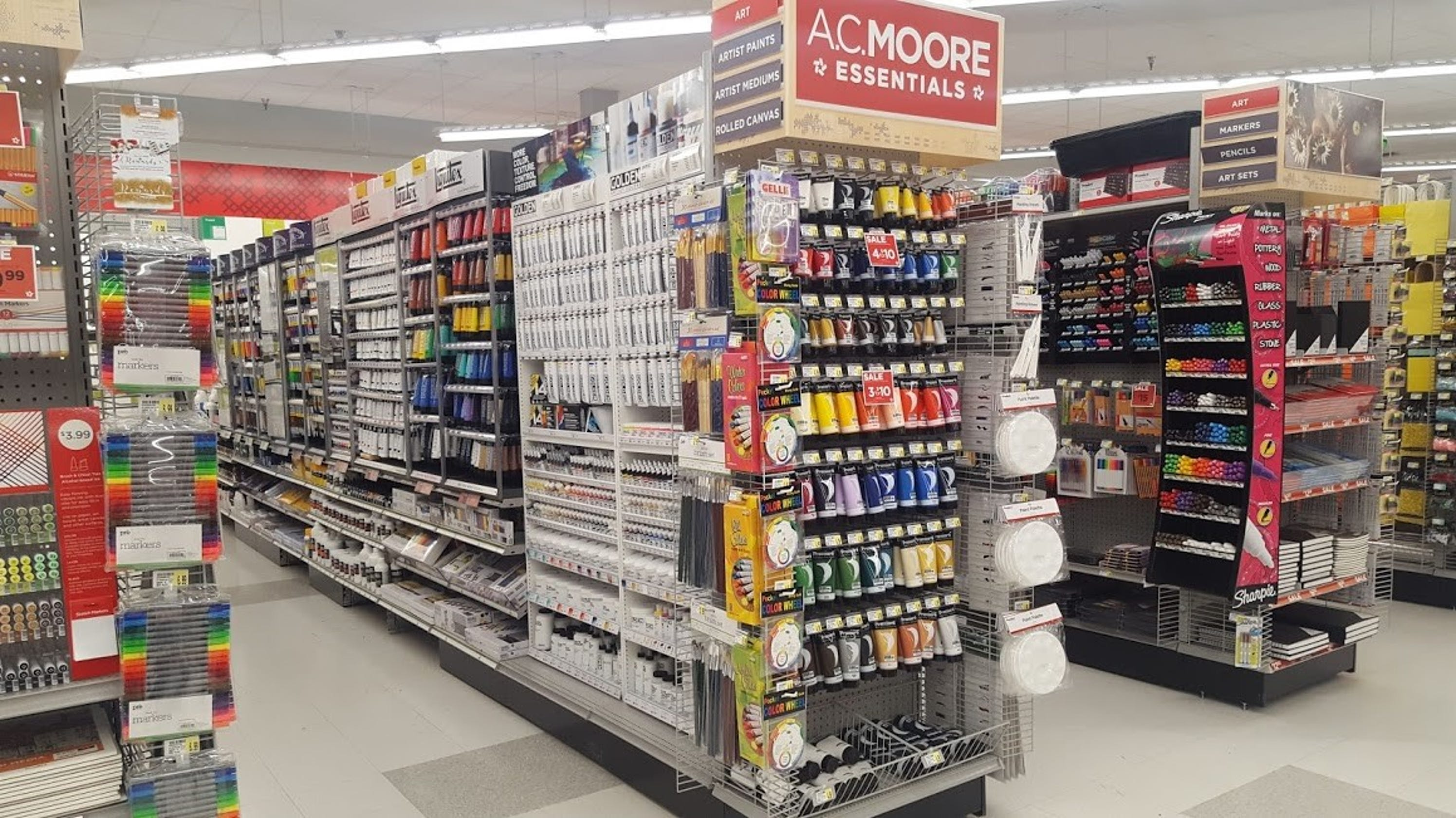 a c moore essentials brings new store idea to wall