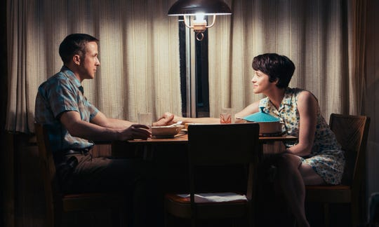 "Ryan Gosling, left, and Claire Foy in a scene from ""First Man."""