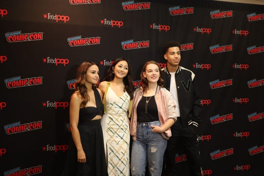 """The cast and creator of """"She-Ra,"""" from left, Aimee Carrero (voice of Adora/She-Ra), Karen Fukuhara (voice of Glimmer), executive producer Noelle Stevenson and Marcus Scribner (voice of Bow)."""