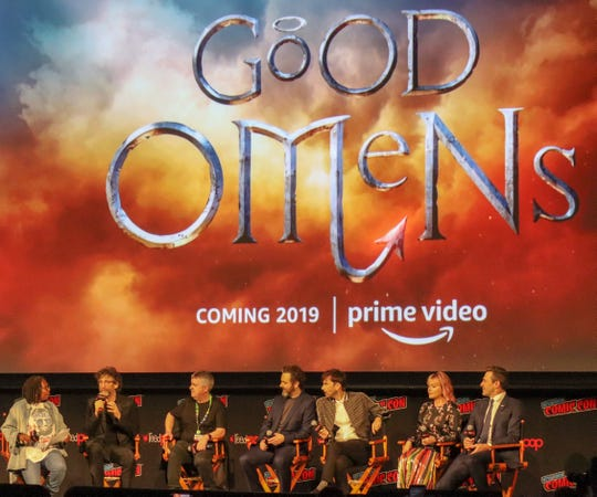 """The cast and creators Amazon's upcoming series """"Good Omens"""" during a panel moderated by Whoopi Goldberg at New York Comic Con 2018."""